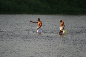 Pilgrims cross the river in the plains, far from the forests and the mountains. Here in the plains the river is a crucial part of life and culture